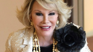 Joan Rivers, the American trailblazer of comedy and TV personality, has died at the age of 81. (AP / Lionel Cironneau)