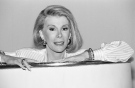 "Joan Rivers, the acid-tongued comedian who crashed the male-dominated realm of late-night talk shows and turned Hollywood red carpets into danger zones, has died at 81. CTVNews.ca takes a look back at some of Rivers&#39; iconic moments in showbiz.<br><br>In this Aug. 15, 1989 photo, Joan Rivers announces that she is starting a new syndicated talk show, ""The Joan Rivers Show,"" in Los Angeles. (AP / Nick Ut)"