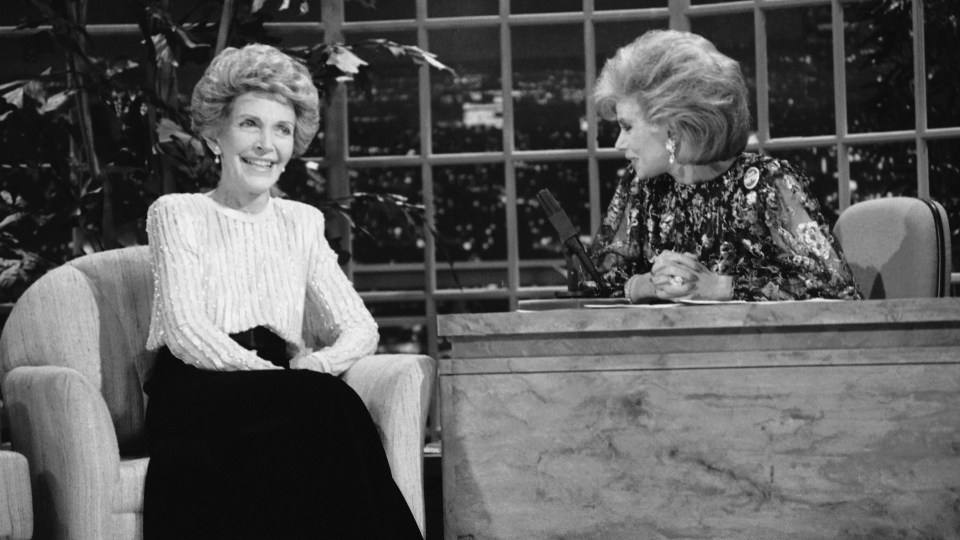Talk show host Joan Rivers, right, talks with guest, first lady Nancy Reagan, during her appearance on 'The Late Show Starring Joan Rivers,' in Los Angeles on Oct. 30, 1986. (AP / Reed Saxon)