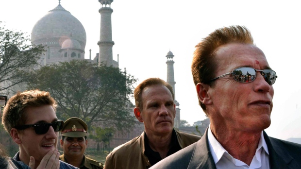 Arnold Schwarzenegger stands in front of the historic Taj Mahal, in Agra, India, Friday, Feb. 3, 2012. (AP / Pawan Sharma)