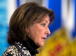 Education Minister Karen Casey fields a question at a news conference in Halifax on Wednesday, Feb. 19, 2014. (Andrew Vaughan / THE CANADIAN PRESS)
