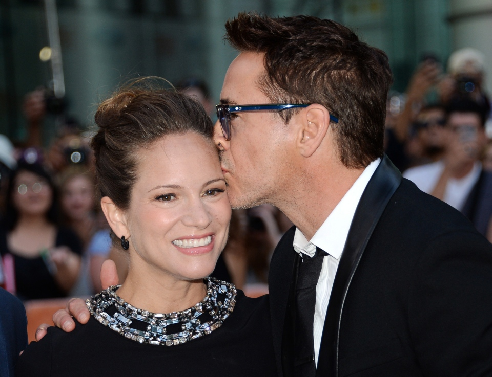 Actor Robert Downey Jr. and wife producer Susan Downey arrive at opening night gala premiere of 'The Judge' during the 2014 Toronto International Film Festival on Thursday, Sept. 4, 2014, in Toronto. (Photo by Evan Agostini/Invision/AP)