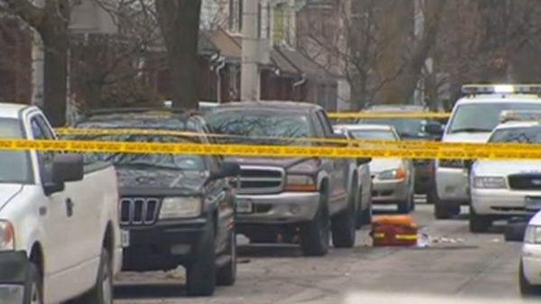 Police are on the scene of shooting that involved another officer in Toronto, Friday, Feb. 3, 2011.