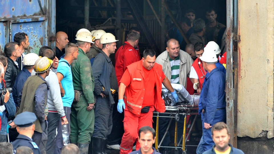 Rescue workers prepare a stretcher for a fellow miner who was injured while he was trapped in coal mine Raspotocje in Zenica, 70 kilometres north of Sarajevo, Bosnia, on Friday, Sept. 5, 2014. (AP / STR)