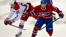 Washington Capitals' Mathieu Perreault and Montreal Canadiens' Raphael Diaz collide during first period NHL hockey action Saturday, February 4, 2012 in Montreal. THE CANADIAN PRESS/Paul Chiasson