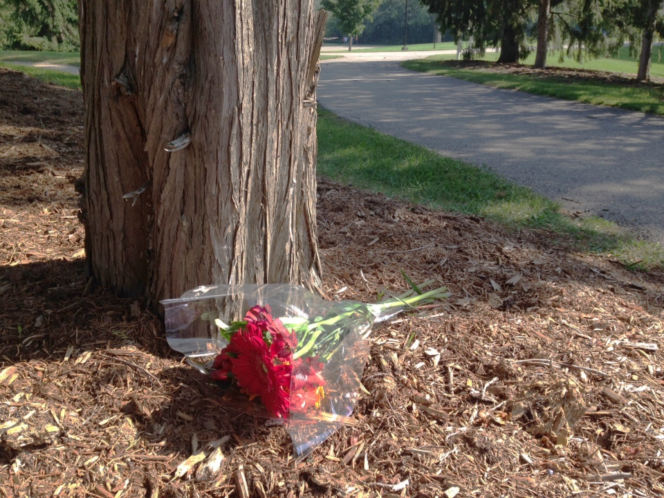 Flowers are left near where an 18-year-old University of Waterloo student was fatally hit by lightning on Friday, Sept. 5, 2014. (David Imrie / CTV Kitchener)
