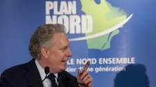 Quebec Premier Jean Charest speaks of tourism for the Plan Nord, a northern Quebec development plan, Wednesday, November 23, 2011 in Quebec City. THE CANADIAN PRESS/Jacques Boissinot