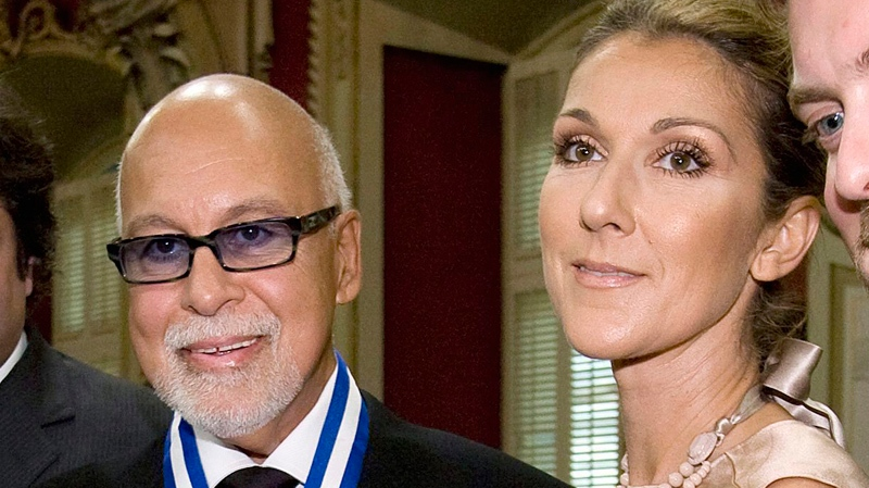 Rene Angelil (left) seen with wife Celine Dion, has reportedly purchased Schwartz's delicatessan. (CP file photo)