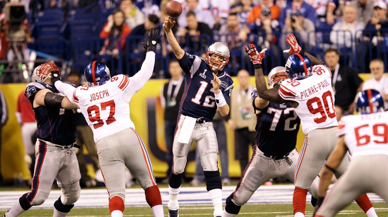 New England Patriots quarterback Tom Brady (12) throws a pass during the first half of the NFL Super Bowl XLVI football game against the New York Giants, Sunday, Feb. 5, 2012, in Indianapolis. (AP / David J. Phillip)
