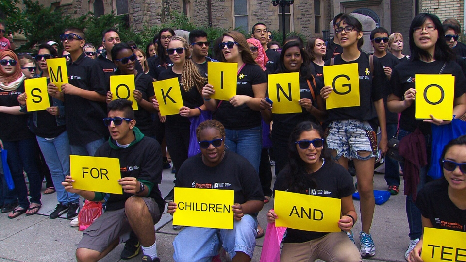 This screengrab shows a flash mob that protested smoking in movies outside a screening of 'St. Vincent' at the Toronto International Film Festival on Saturday, Sept. 6.