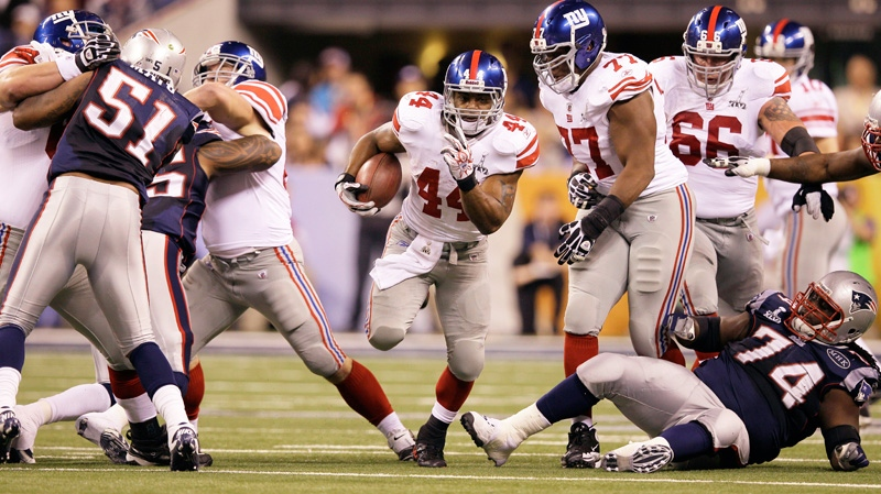 New York Giants running back Ahmad Bradshaw (44) runs through a hole in the line during the first half of the NFL Super Bowl XLVI football game against the New England Patriots, Sunday, Feb. 5, 2012, in Indianapolis. (AP / Mark Humphrey)