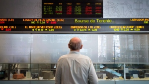 A man watches the financial numbers at the TMX Group in Toronto's financial district, May 9, 2014. (Darren Calabrese / THE CANADIAN PRESS)