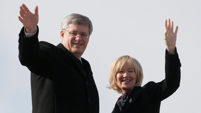 Prime Minister Stephen Harper and his wife Laureen board a government aircraft as they prepare to depart from Ottawa, Monday, Feb. 6, 2012. (Adrian Wyld / THE CANADIAN PRESS)