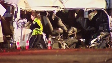 The wreckage of a van is seen after a two-vehicle collision that has killed at least 11 people in Hampstead, Ont., on Monday, Feb. 6, 2012.