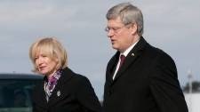Canadian Prime Minister Stephen Harper and his wife Laureen board a government aircraft as they prepare to depart from Ottawa on Monday February 6, 2012. (Adrian Wyld / THE CANADIAN PRESS)