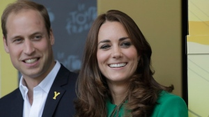 Kate, Duchess of Cambridge and Prince William watch the podium ceremony of the first stage of the Tour de France cycling race over 190.5 kilometres with start in Leeds and finish in Harrogate, England, Saturday, July 5, 2014. (AP /Laurent Cipriani)