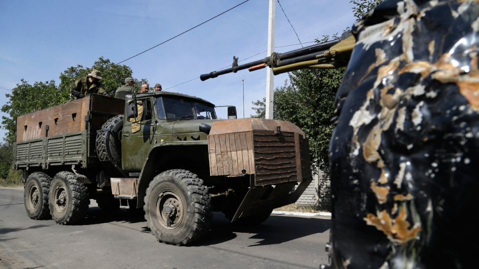 Pro-Russian rebels drive an armored truck in Donetsk, eastern Ukraine, Sunday, Sept. 7, 2014. (AP / Sergei Grits)