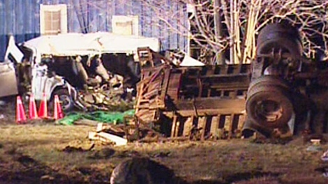 The wreckage of two vehicles is seen after a collision that has killed at least 11 people in Hampstead, Ont., on Monday, Feb. 6, 2012.