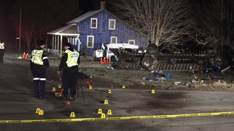 OPP are at the scene of a two-vehicle collision that has killed at least 11 people in Hampstead, Ont. on Monday, Feb. 6, 2012. (Tom Podolec / CTV News)