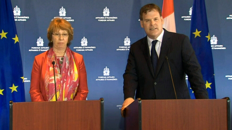 Foreign Affairs Minister John Baird speaks with his EU counterpart, Catherine Ashton in Ottawa, Monday, Sept. 8, 2014.