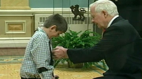Nine-year-old Bryden Hutt of Yarmouth receives a Queen Elizabeth the Second Diamond Jubilee Medal from Governor General David Johnston at Rideau Hall on Monday.  Bryden was one of several Maritimers to receive the honour.
