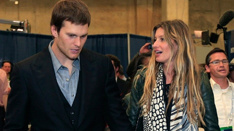 New England Patriots quarterback Tom Brady and his wife, supermodel Gisele Bundchen, leave the stadium after the Patriots lost 21-17 to the New York Giants in the NFL Super Bowl XLVI football game, Sunday, Feb. 5, 2012, in Indianapolis. (AP / Mark Humphrey)