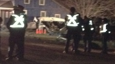 OPP are at the scene of a two-vehicle collision that has killed at least 11 people in Hampstead, Ont. on Monday, Feb. 6, 2012. (David Imrie / CTV News)