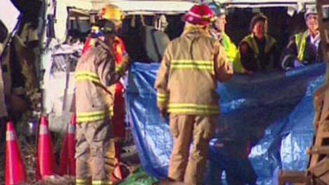 OPP and firefighters are at the scene of a two-vehicle collision that has killed at least 11 people in Hampstead, Ont.. on Monday, Feb. 6, 2012.