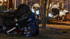 Ontario Provincial Police and emergency crews investigate a multiple fatal motor vehicle accident near Hampstead, Ont., Monday, Feb. 6, 2012. (Dave Chidley / THE CANADIAN PRESS)