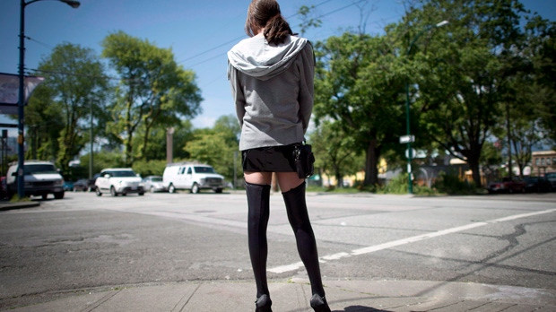 A sex trade worker is pictured in downtown Vancouver, B.C., on Wednesday, June, 3, 2014. (The Canadian Press/Jonathan Hayward)