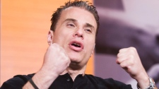 Michael Landsberg, host of the show Off The Record takes part in a taping of the show in Toronto. (Jonathan Hayward / THE CANADIAN PRESS)