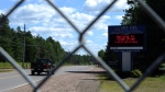 A sign welcomes people at the entrance to the Chalk River Laboratories Chalk River, Ont., on Monday, July 9, 2012. (THE CANADIAN PRESS / Sean Kilpatrick)