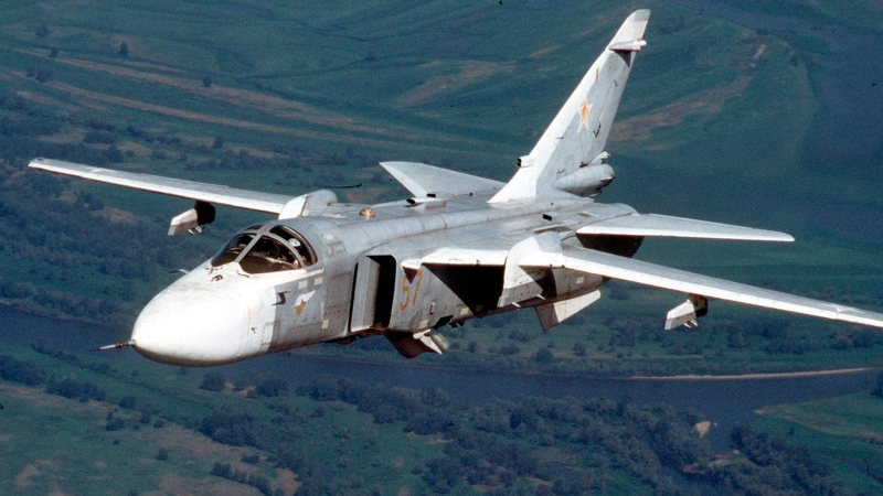 A Russian Su-24 attack aircraft, known by NATO as 'Fencer,' flies somewhere at an undisclosed location in Russia in this 2002 file photo. (AP Photo)
