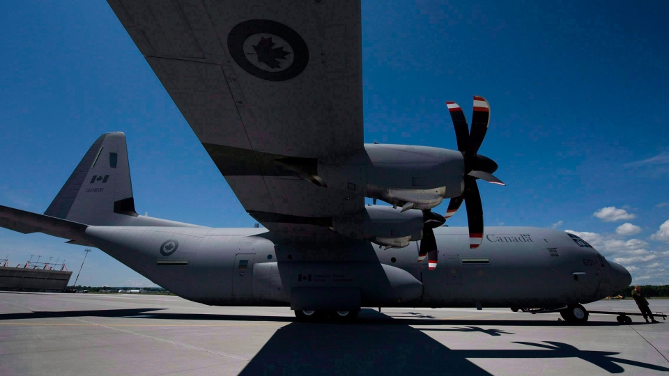 A CC-130 J Hercules aircraft sits on the tarmac at Canadian Forces Base (CFB) Trenton on June 4, 2010. (Adrien Veczan / THE CANADIAN PRESS)