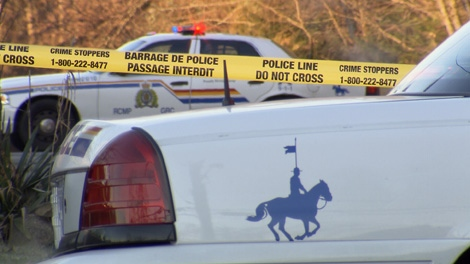 Two RCMP vehicles, along with police tape are shown in this undated file photo.