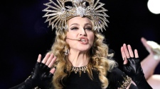 Madonna performs during halftime of the NFL Super Bowl XLVI football game between the New York Giants and the New England Patriots, Sunday, Feb. 5, 2012, in Indianapolis. (AP / Chris O'Meara)