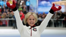 Calgary 1988 Olympic silver medalist in figure skating Elizabeth Manley, of Canada, waves to the crowd prior to skating with gold medallist Katarina Witt, of Germany, in Vancouver, B.C., on Sunday, Feb. 7, 2010.