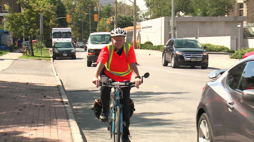 Deputy Police Chief Jill Skinner rides her bike the day after getting 'doored' by a driver despite wearing bright reflective material.