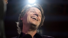 Jim Cuddy of Blue Rodeo reacts to a journalist's question as he's interviewed following the Juno Award nominations announcement in Toronto on Tuesday, Feb. 7 , 2012. (Chris Young / THE CANADIAN PRESS)
