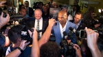Reporters surround Toronto Mayor Rob Ford, left, and former heavyweight boxing champion Mike Tyson following a closed-door meeting between the two at City Hall in Toronto on Tuesday, Sept. 9, 2014. (Darren Calabrese / THE CANADIAN PRESS)