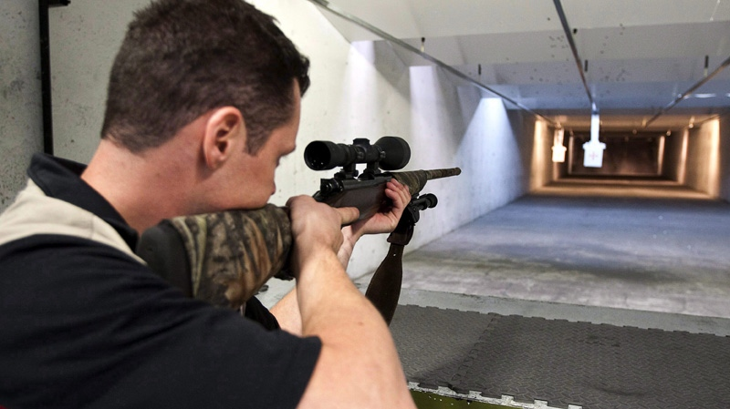 In this Sept. 15, 2010 photo, range officer Patrick Deegan aims a long gun at a private range in Calgary. (THE CANADIAN PRESS/Jeff McIntosh)
