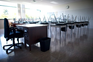 An empty teacher's desk is seen at the front of a empty classroom at McGee Secondary school in Vancouver, Friday, Sept. 5, 2014. (Jonathan Hayward / THE CANADIAN PRESS)