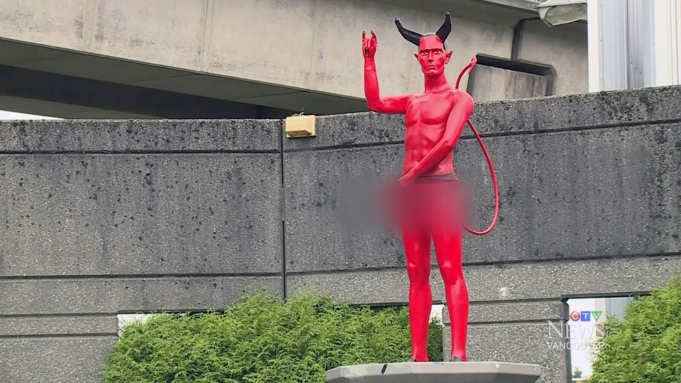 A naked red Satan statue was removed by city crews in Sept. 2014.