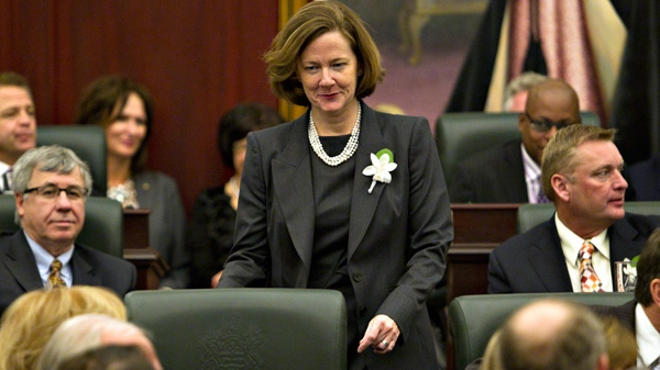 Alberta Premier Alison Redford makes her way to her seat before the Speech from the Throne at the Alberta Legislature in Edmonton on Tuesday Feb. 7, 2012. (Jason Franson / THE CANADIAN PRESS)