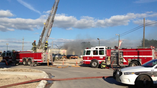 Crews battled the fire at Molson and Panet in Winnipeg on Wednesday afternoon at Giardino International Auto & Tire Centre.
