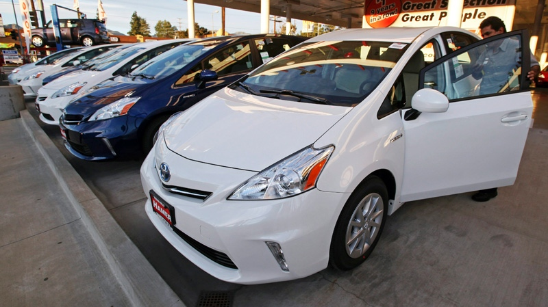 An employee parks a Toyota gas-electric hybrid automobile in a row of similar cars at a dealership in Los Angeles, Thursday, Jan. 26, 2012. (AP / Reed Saxon)