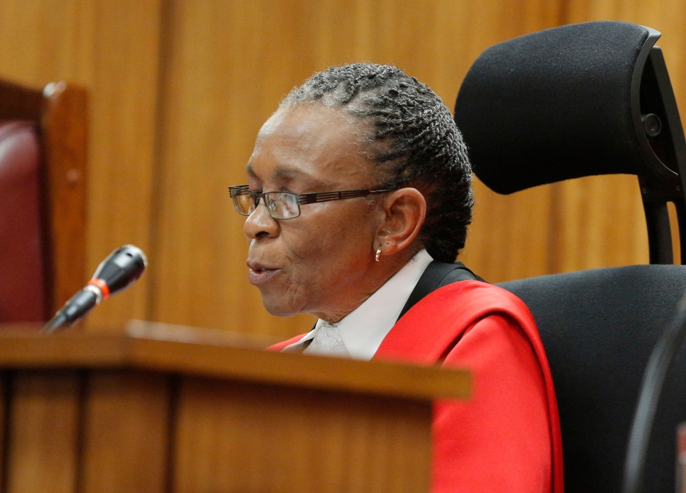 Judge Thokozile Masipa reads notes as she delivers her verdict in the Oscar Pistorius murder trial, in Pretoria, South Africa, Thursday, Sept. 11 2014. (AP / Kim Ludbrook)