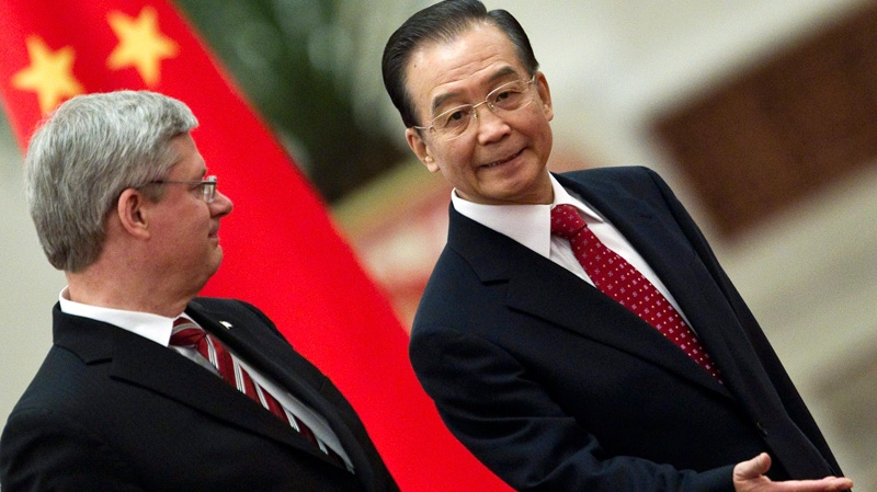Chinese Premier Wen Jiabao, right, invites Prime Minister Stephen Harper to review an honor guard during a welcoming ceremony at the Great Hall of the People in Beijing, Wednesday, Feb. 8, 2012. (AP / Alexander F. Yuan)