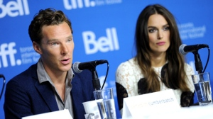 """Benedict Cumberbatch, left, and Keira Knightley attend the press conference for """"The Imitation Game"""" on day 6 of the Toronto International Film Festival at the TIFF Bell Lightbox on Tuesday, Sept. 9, 2014, in Toronto. (Photo by Evan Agostini/Invision/AP)"""