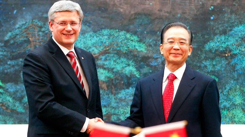 Prime Minister Stephen Harper, left, shakes hands with Chinese Premier Wen Jiabao at the end of a signing ceremony held at the Great Hall of the People in Beijing Wednesday, Feb. 8, 2012. (AP / Diego Azubel)